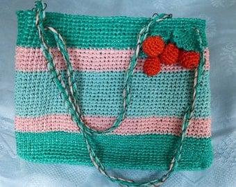Rafia hand made handbag in various colours.