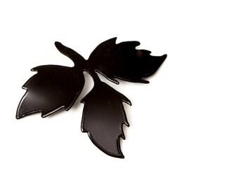 Black brooch with three leaves