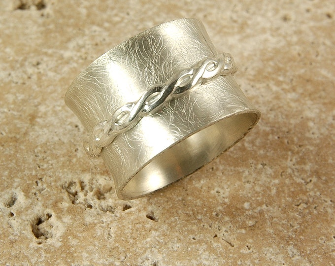 Custom handcrafted sterling silver textured ring with free spinning celtic band