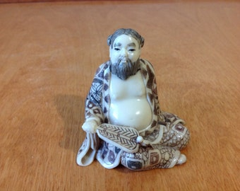 Carved Faux Ivory Figurine of a Asian Man with a Fan