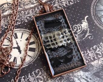 Rectangular burlap and lace resin pendant