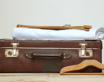 French vintage brown suitcase in vulcanised fiber dating fifties With a lovely embroidery on a strap