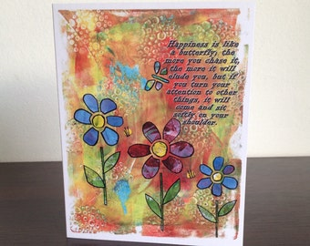 "Card. Quote. ""Happiness is like a butterfly; the more you chase it..."" Flowers and butterfly design. Orange. Multicolored."