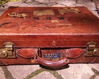 Well-traveled vintage leather suitcase