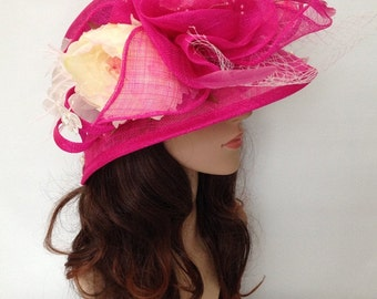 A Fuchia Pink Sinamay Church Hat With Flowers,Net And Feather