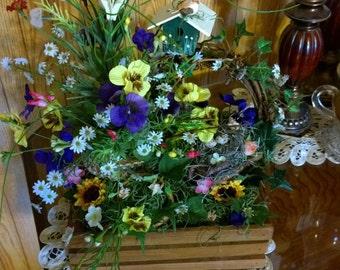 Floral arrangement in wooden crate