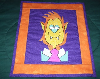 Werewolf that is really cute and not scary at all. This quilt is machine quilted and ready to hang.