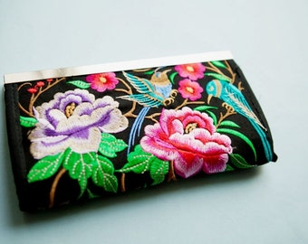 Embroidered clutch purse with nickel/silver finish clasp