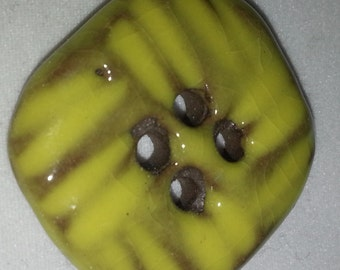 Four yellow ceramics buttons from 1960s