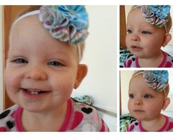 Girls fabric headband.  I have already made headbands. I can also make custom headbands.
