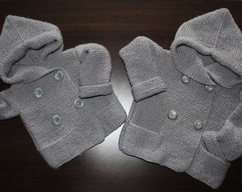 Wool Baby Sweater with a hood.