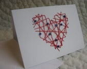 hand embroidered red heart with blue beads valentine card