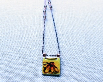 Handpainted enamel necklace with a sunflower theme accented with smoky quartz gemstones