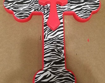 Handcrafted wooden cross with zebra