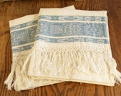 Vintage linen damask towels with blue patterns and fringes. Around 1930's