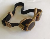 Handmade Steampunk goggles made of brass and leather   with a leather case.