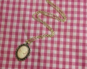 Pink Cameo pendant on long chain