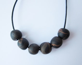 Understated woodgrain bead necklace  polymer clay bead and cotton cord necklace