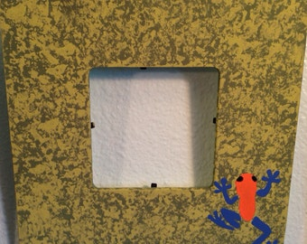 Poison dart frog picture frame with plastic insert
