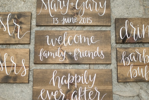Set of rustic wood wedding signs hand lettered by