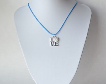 "Volleyball necklace with metal ""volleyball love"" pendant on nylon cord"
