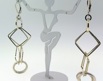 Sterling silver dangle long earrings.