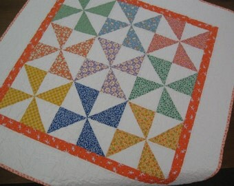 Free shipping in the U.S. for this Reproduction 1930's Pinwheels with Orange Baby Quilt