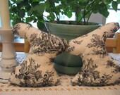 A pair of primitive toile de Jouy fabric bunnies