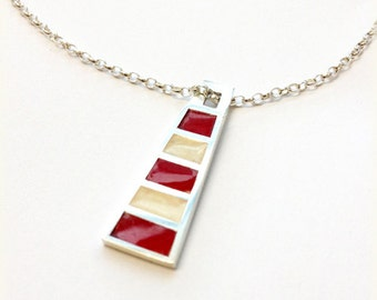 Sterling silver and enamel resin lighthouse pendant.