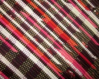 colorful handwoven rag rug made from recycled t-shirts, in black,pink and white