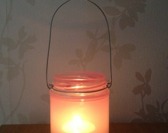 Pink painted glass mason jar hanging tea light candle holder lantern, ideal for indoors, outdoors, weddings & parties.