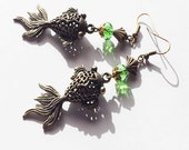 Earrings - Bronze fish with green crystal