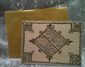 Blank metallic gold note card with henna design and glitter