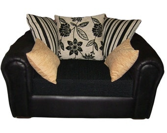 Barcelona Cuddle Chair Upholstered In A Black Faux Suede And Black/Cream Scatter Cushions