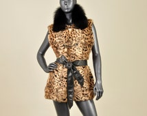 MRDline 6652011 Handmade long stamped rabbit fur vest with a fox fur mao collar. Combined with a leather belt. Stylish and elegant.