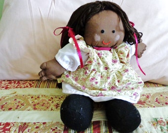 Little Ethnic Girl Doll with Pink Clothing