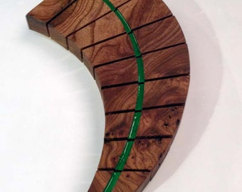 wooden sculpted wall hanging
