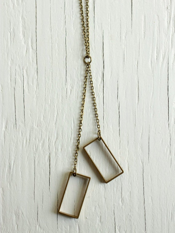 Geometric rectangle necklace with raw brass pendants on a long chain, geometric jewelry