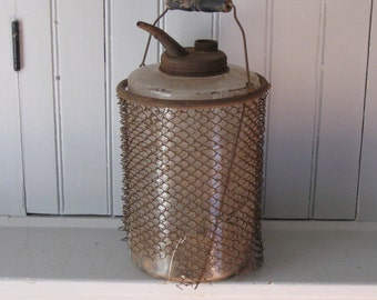 Crusty Kerosene Glass Jar with Spout and Rusty Mesh Carrier Basket