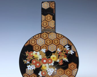 Asian lacquered vanity mirror gold and black floral pattern Japan