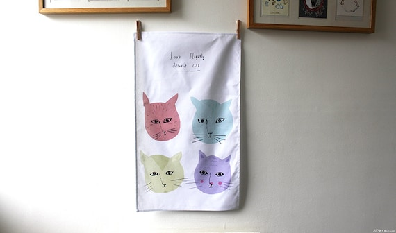 Four slightly different cats towel