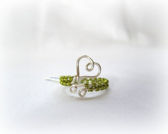 Silver And Peridot Heart Wrap Around Ring