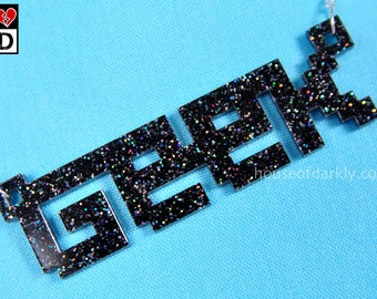 8bit GEEK necklace in black rainbow glitter acrylic special edition with tin gift box