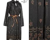 1970s Day Dress - Black Poly w/ Graphic Floral Print & Ribbon Tie Collar Vintage - size Medium Large