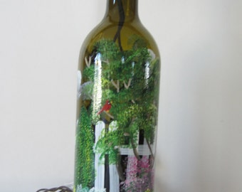 Garden Scene with a White Picket Fence on an Amber  Lighted Wine Bottle