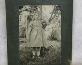 Little Girl in Gingham Dress-Standing by Tree Outdoors-Antique Cabinet Photo