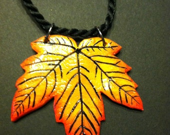Tiger striped maple leaf necklace handmade from a real leaf.  2in x 2in. Shipping included.
