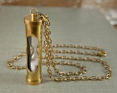 Brass hourglass necklace