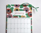 2015 Wall Calendar, 5.5x8.5 inches featuring 12 different floral pattern illustrations in mint green, yellow, peach, pink, teal and brown