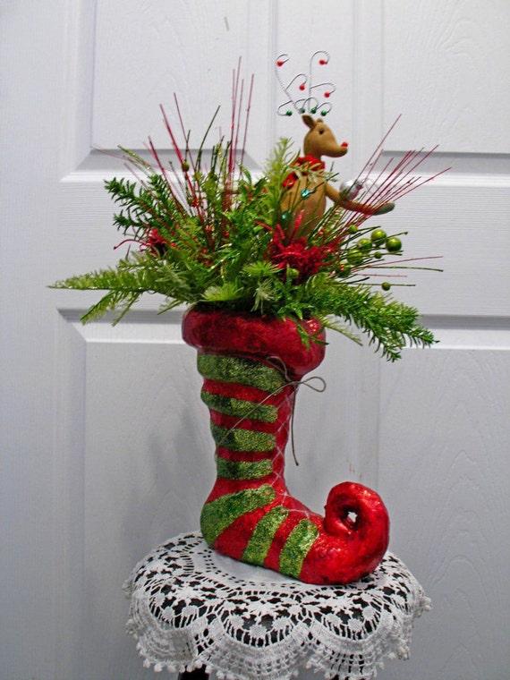 whimsical elf boot floral arrangement    reindeer decor    red